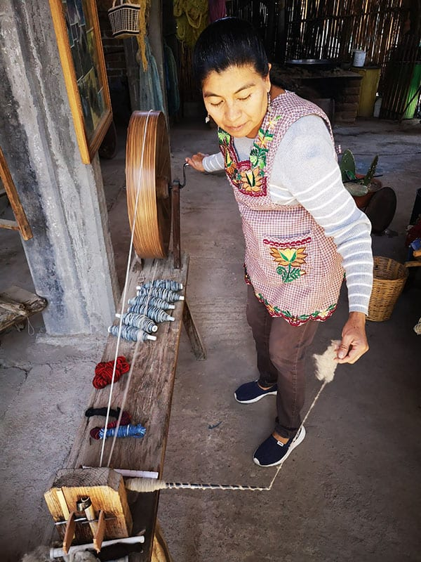 Spinning wool for a new Mexican wool rug