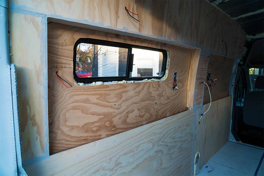 Installing camper van walls - adding spackle to our walls
