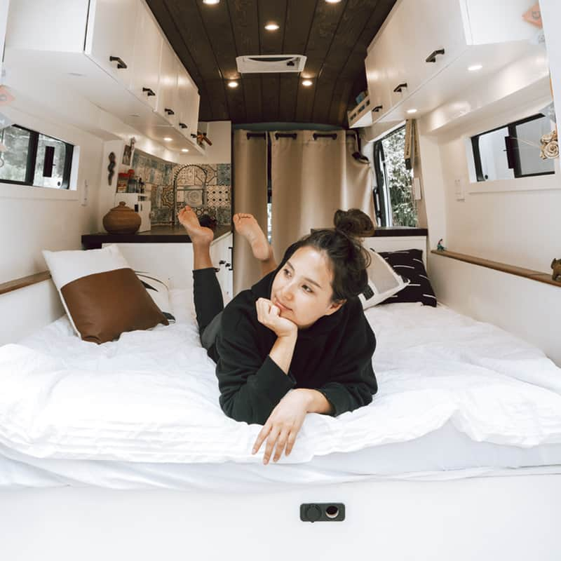 Woman living van life - Thinking About The Best Vans For Van Life