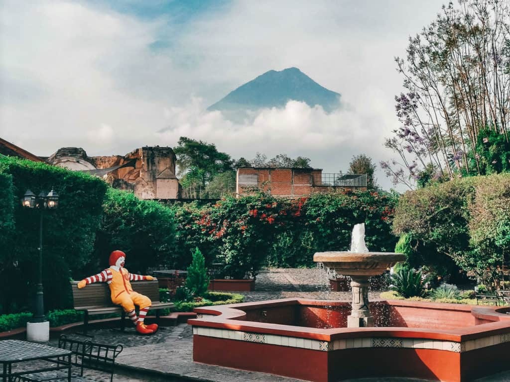 Courtyard Inside McDonalds In Antigua Guatemala With Volcano Agua In The Background