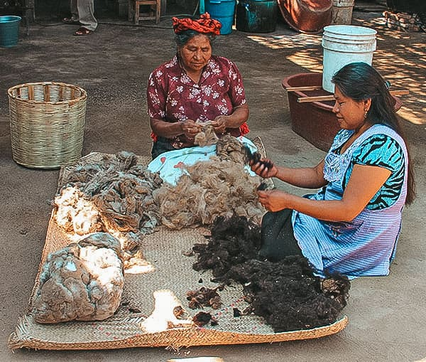 Separating wool by color to make Oaxaca rugs