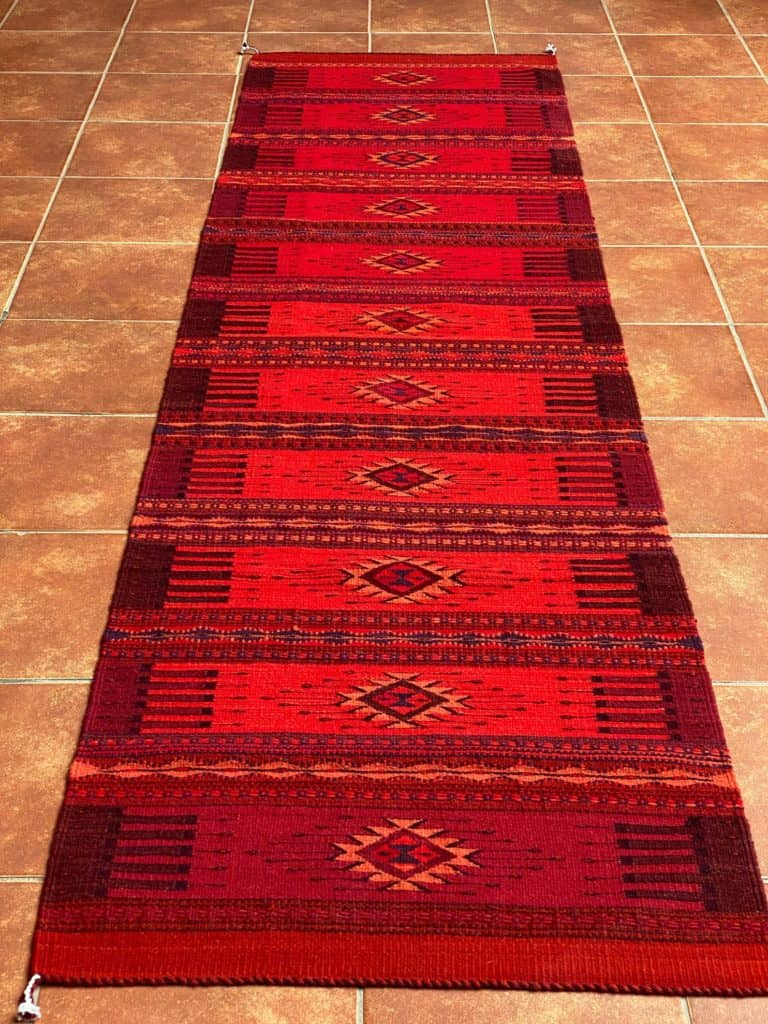 Different shades of red on a Mexican wool rug from Oaxaca - Zapotec style